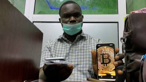 Nigeria's youthful crypto investors defy crackdown to ride bitcoin frenzy